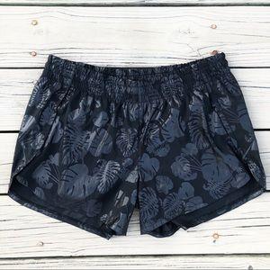 Athleta black running shorts palm leaf tonal print